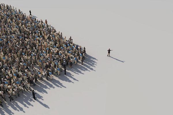 Menschengruppe folgt einer Person